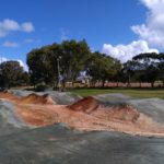 BMX jumps coated with DirtGlue industrial dust suppressant